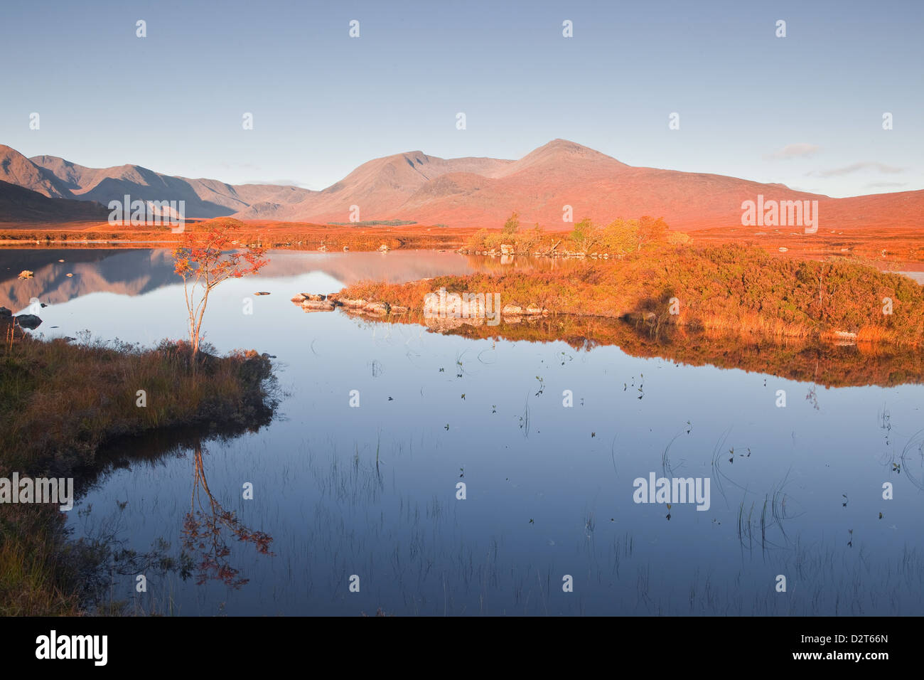 Lochan na h-Achlaise reflecting the surrounding mountains on Rannoch Moor, a Site of Special Scientific Interest, - Stock Image