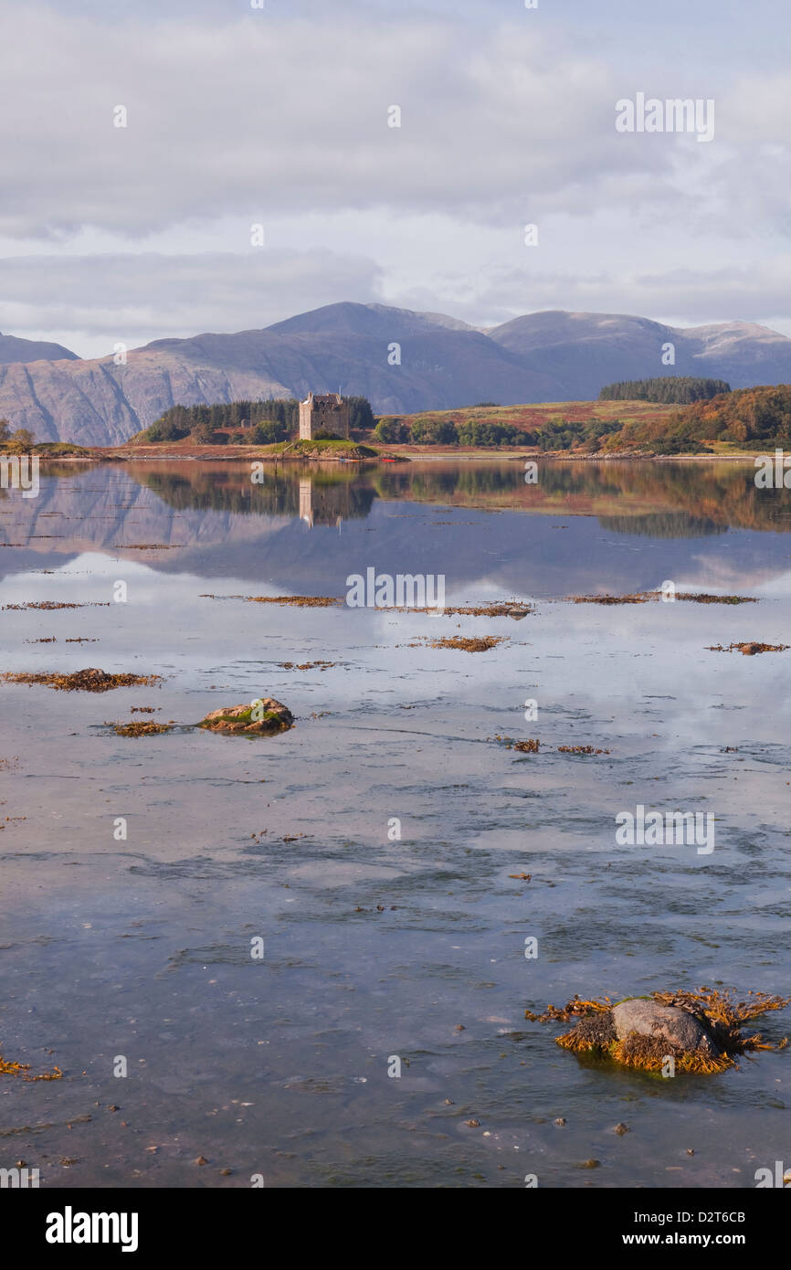 Castle Stalker reflecting into the waters of Loch Laich, Argyll and Bute, Scotland, United Kingdom, Europe - Stock Image