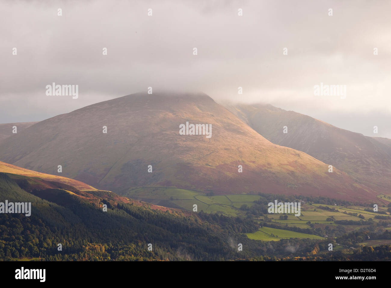The fell of Blencartha is lit up by the morning sun, Lake District National Park, Cumbria, England, United Kingdom, - Stock Image