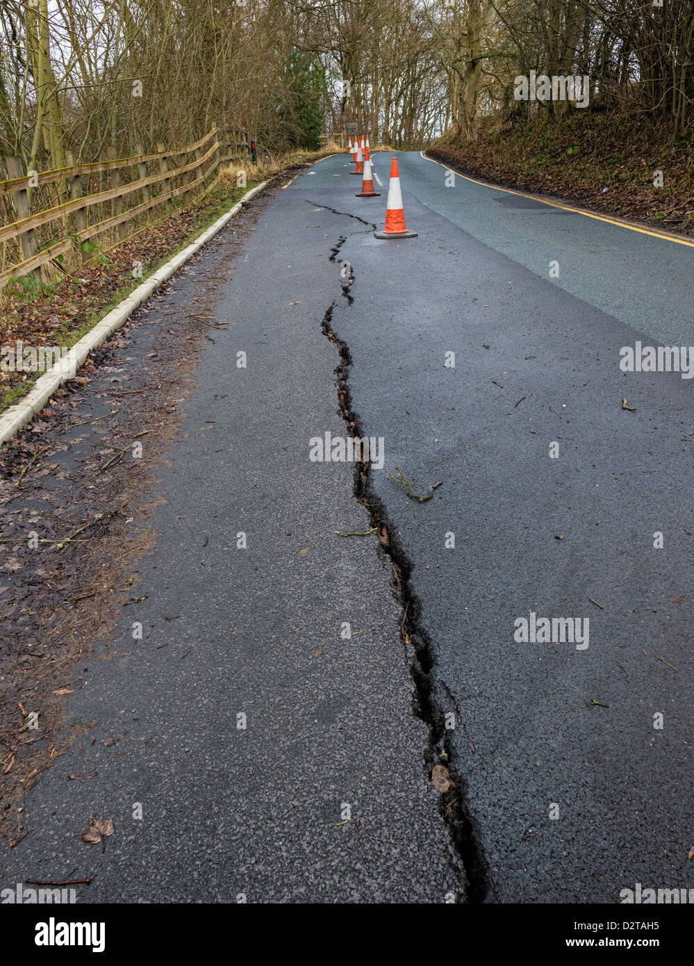 Crack in road due to subsidence - Stock Image