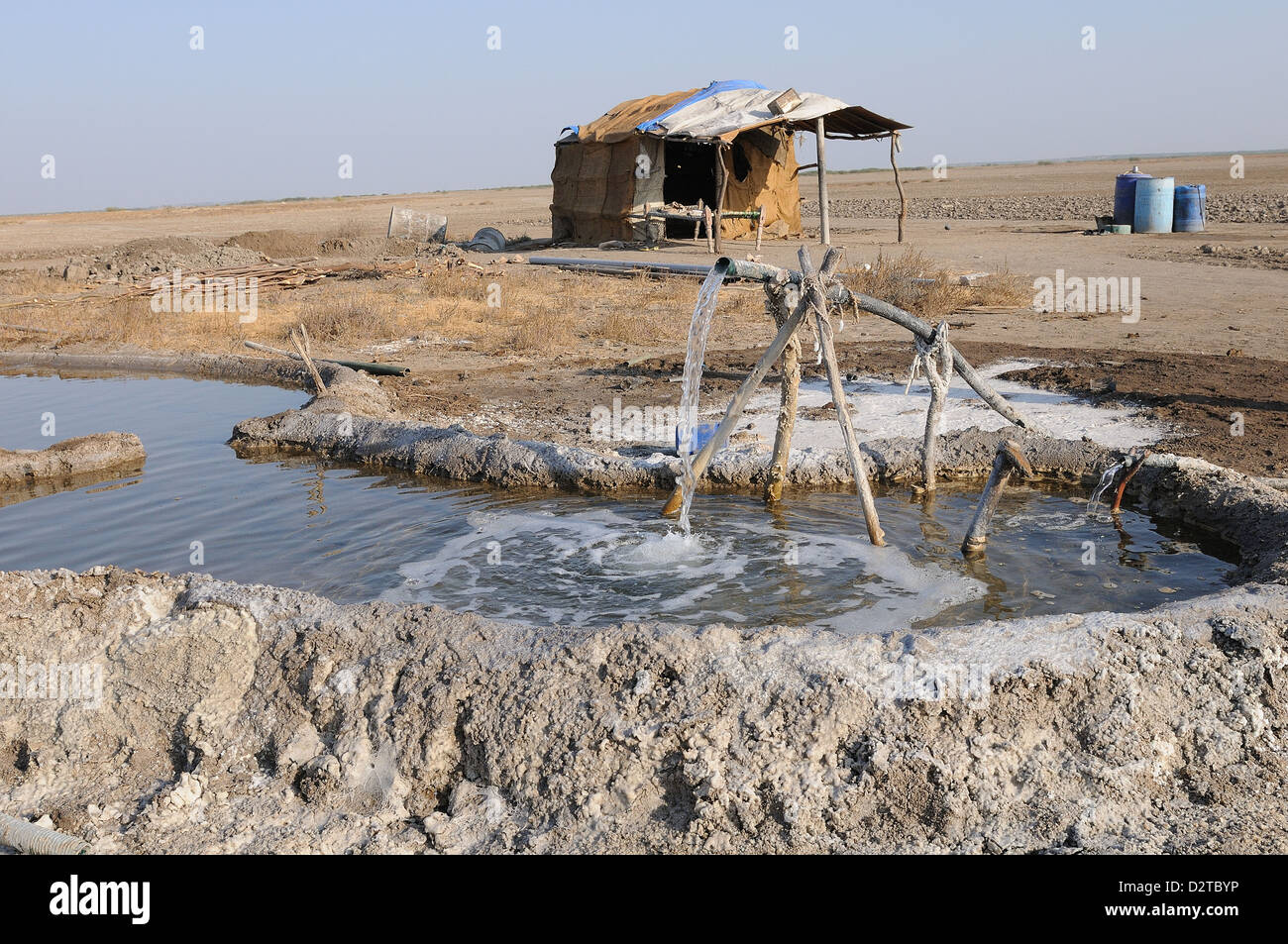 Salt making pit and salt worker's home, Gujarat, India, Asia - Stock Image