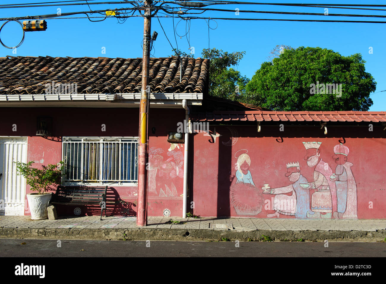 Christmas: Chalk drawing on a red wall in Liberia. Costa Rica - Stock Image