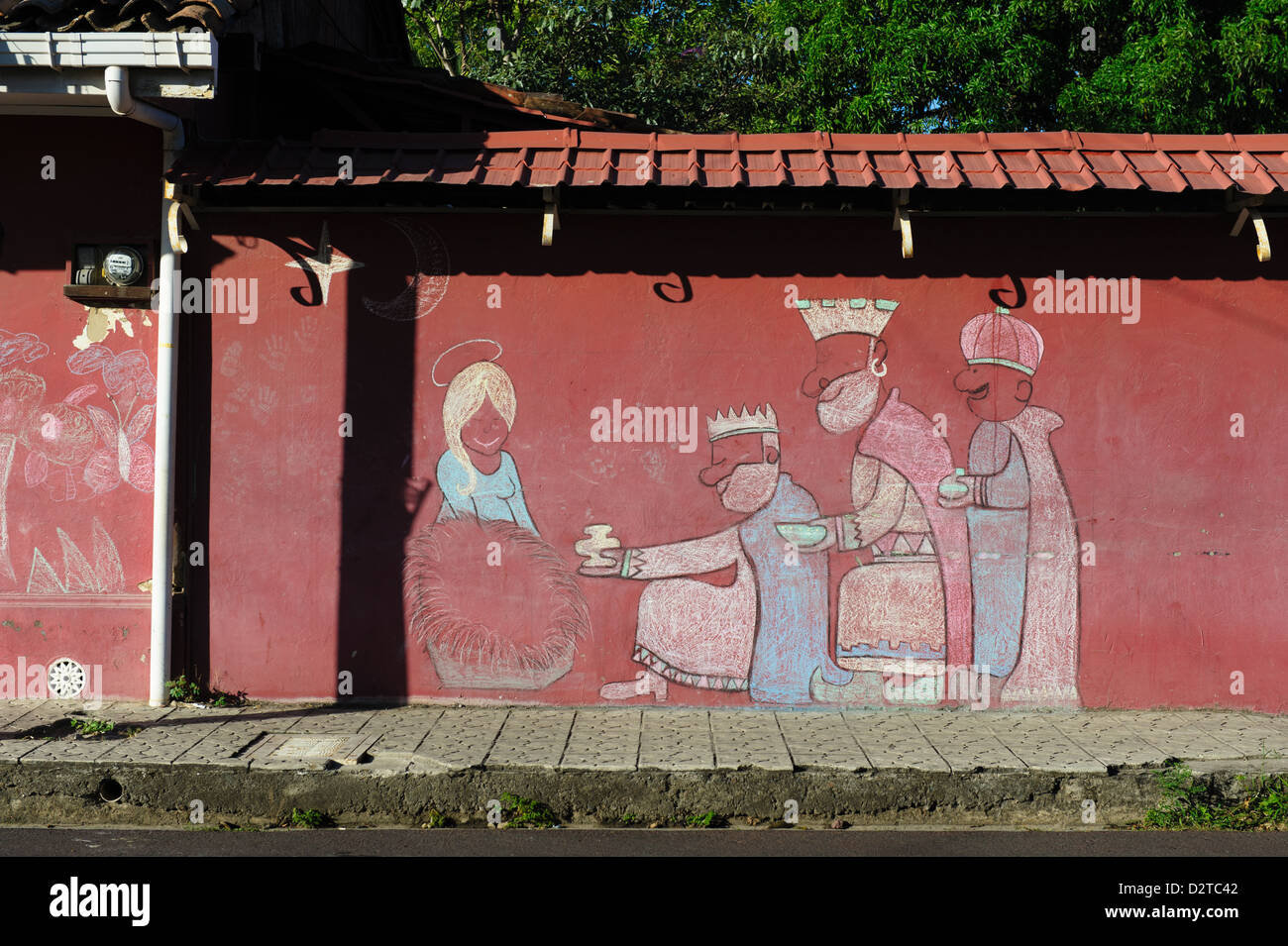 Christmas: Chalk drawing on a red wall in Liberia. Costa Rica Stock Photo
