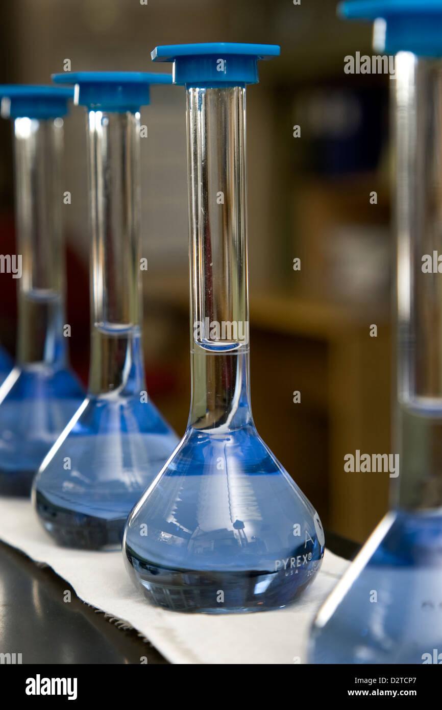 Laboratory beakers in row Stock Photo