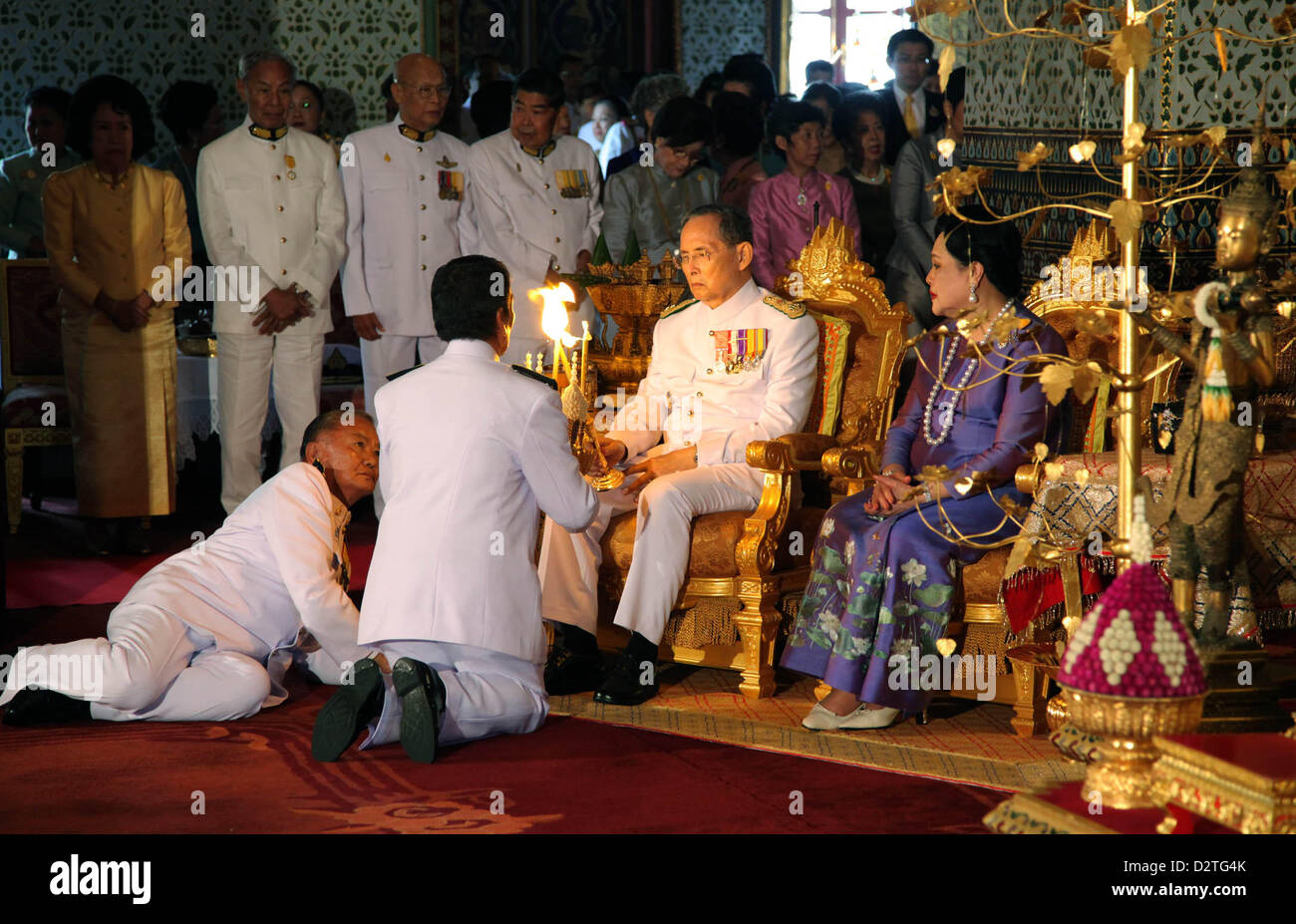 Thailand's monarch Bhumibol Adulyadej and Queen Sirikit preside over a ceremony organised to mark the Coronation - Stock Image