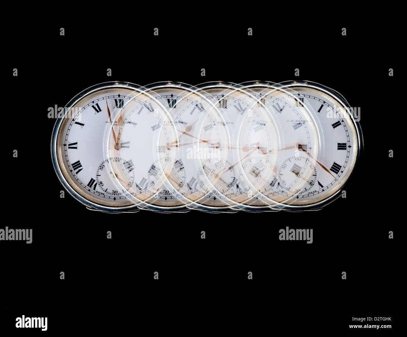 Multiple exposure showing watch face with different times. - Stock Image