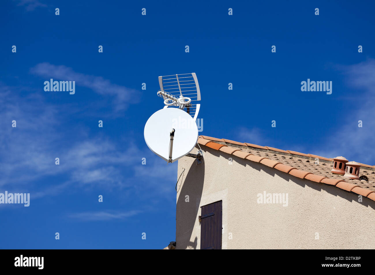 Satellite dish antenna to gable of a house - Stock Image