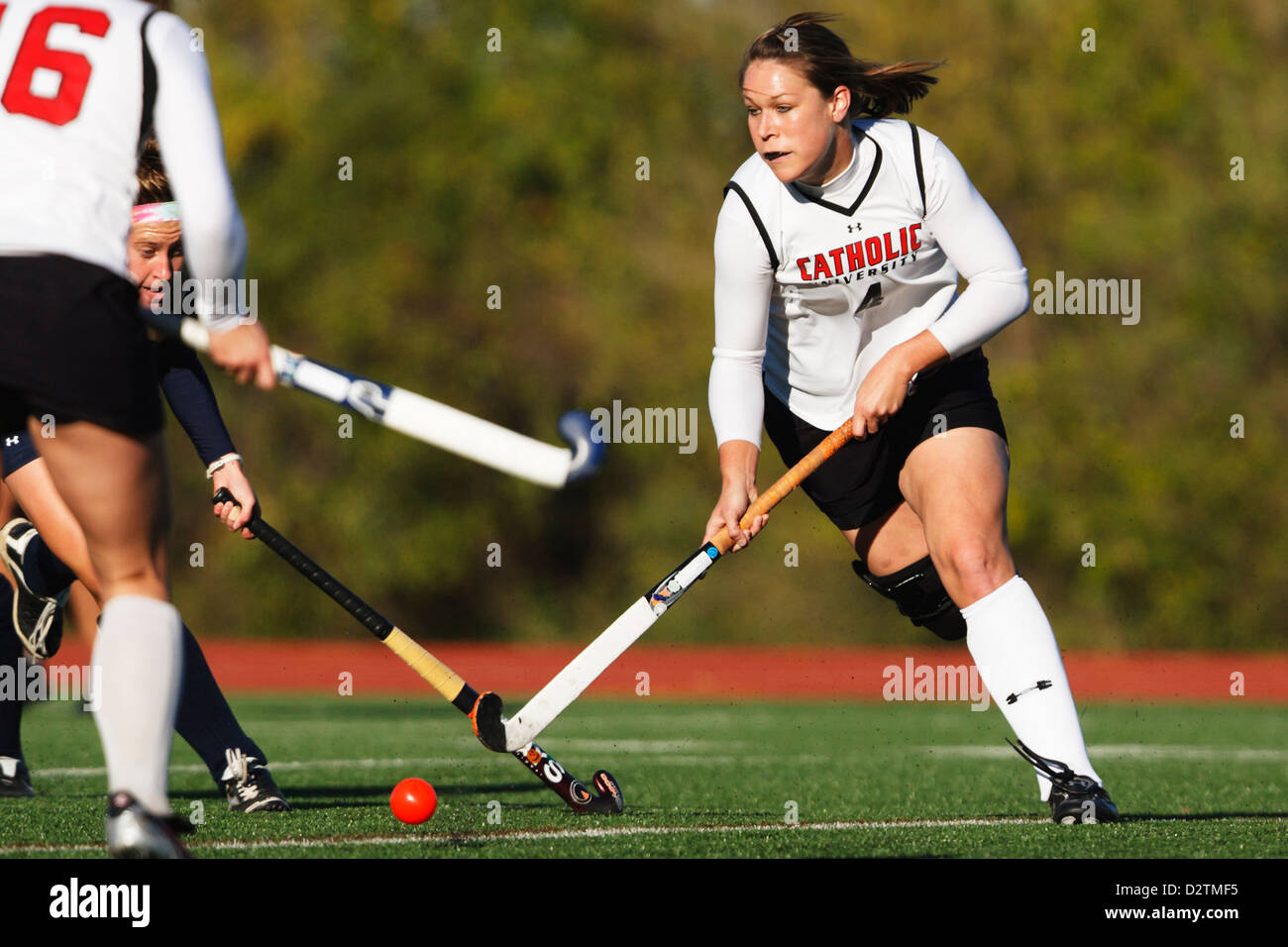 A Catholic University player controls the ball during the Landmark Conference field hockey championship against - Stock Image