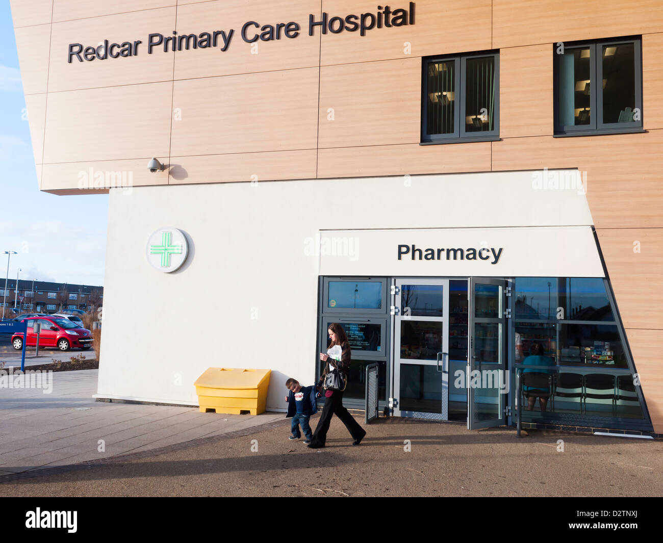 Redcar Primary Care Hospital entrance and Pharmacy mother  and child passing - Stock Image