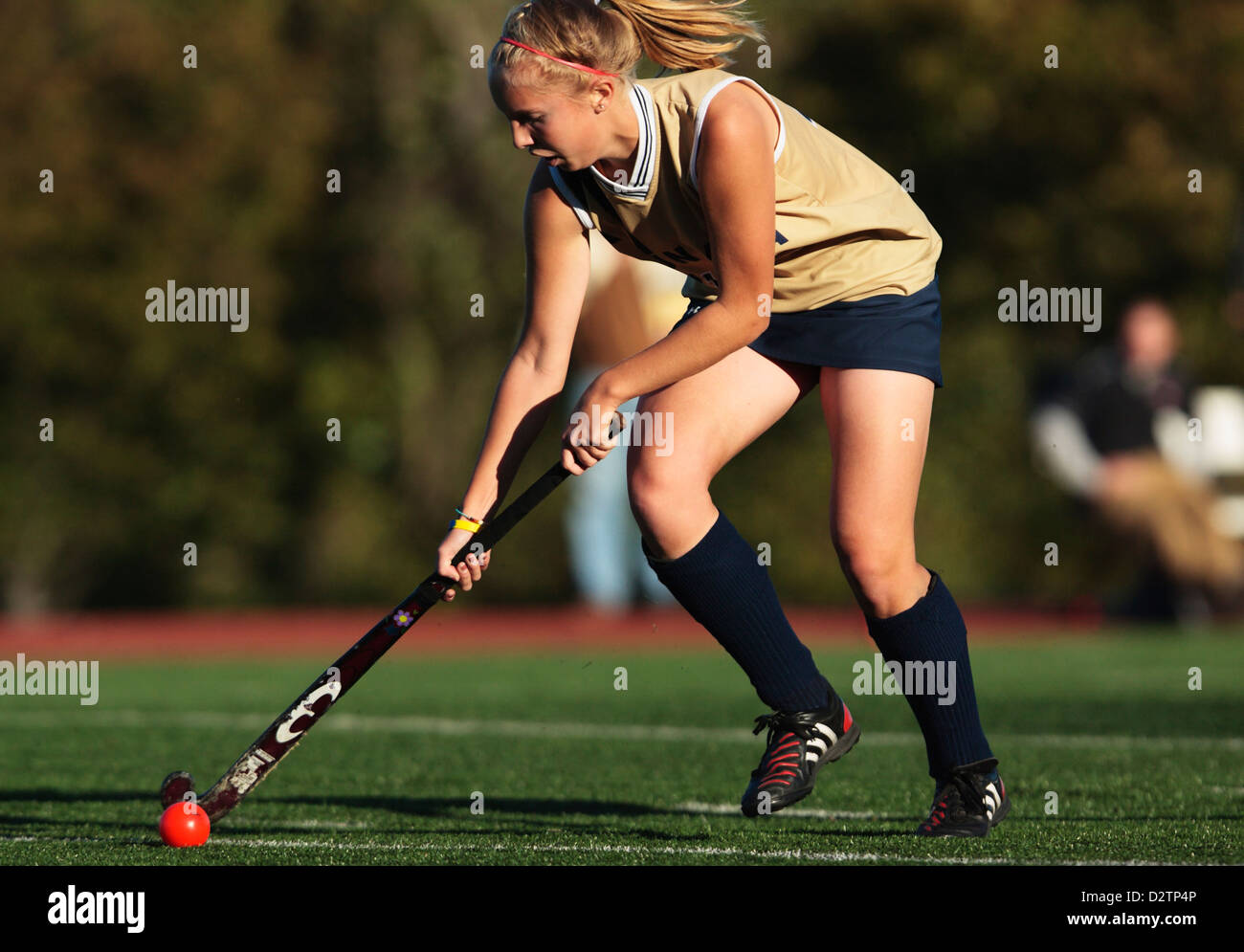 A Juniata College player controls the ball during the Landmark Conference field hockey championship against Catholic - Stock Image