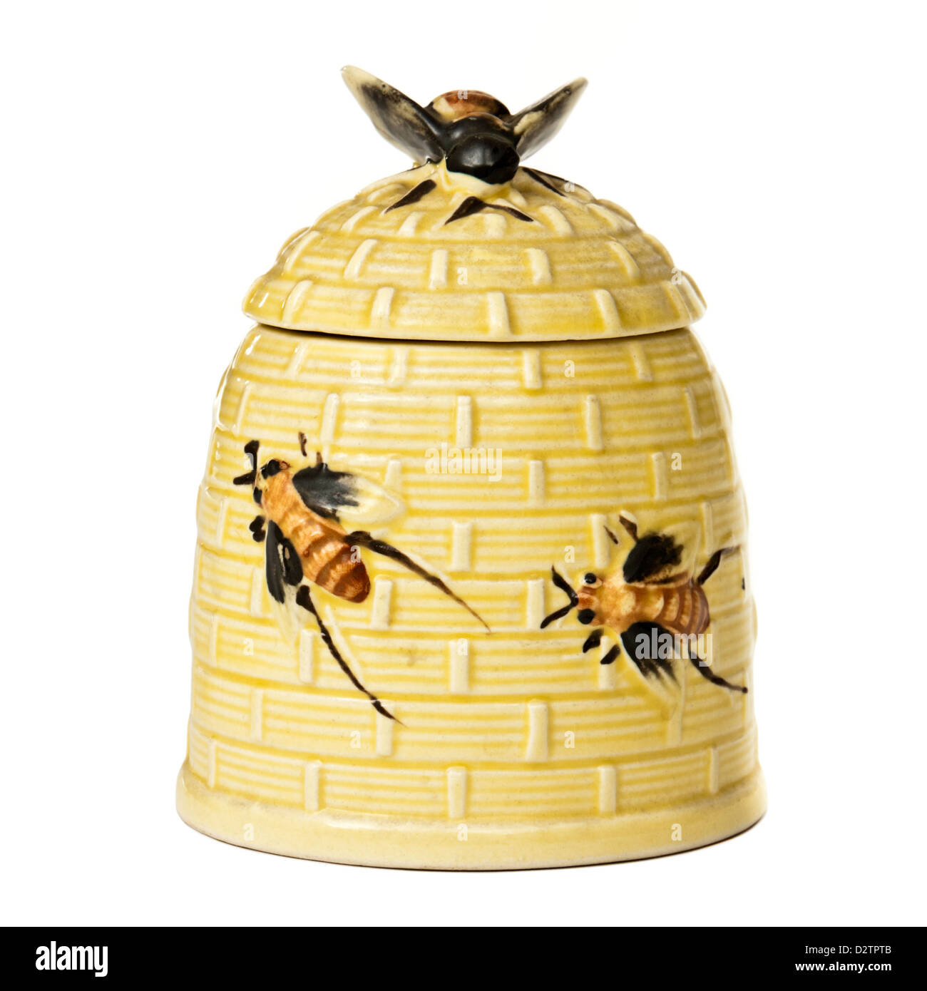 Vintage porcelain beehive-shaped honey pot - Stock Image