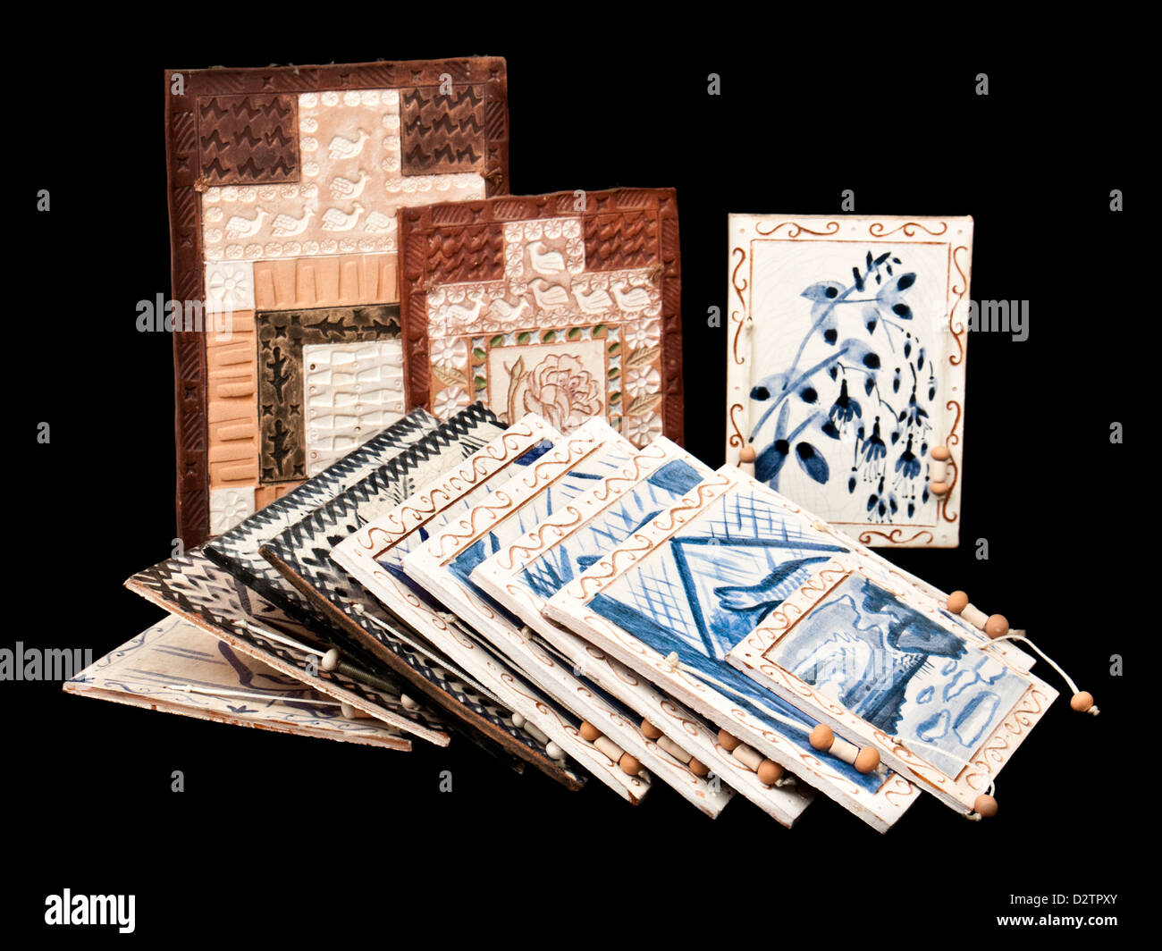 Selection of vintage handmade African ceramic wall tiles - Stock Image