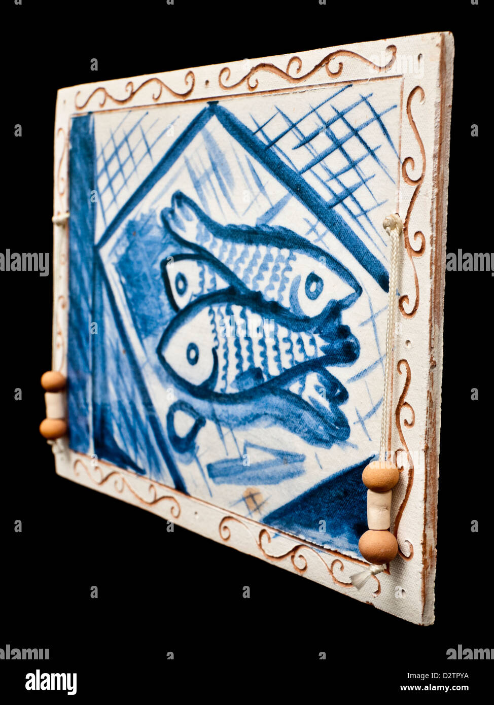 Vintage handmade African ceramic wall tile - Stock Image