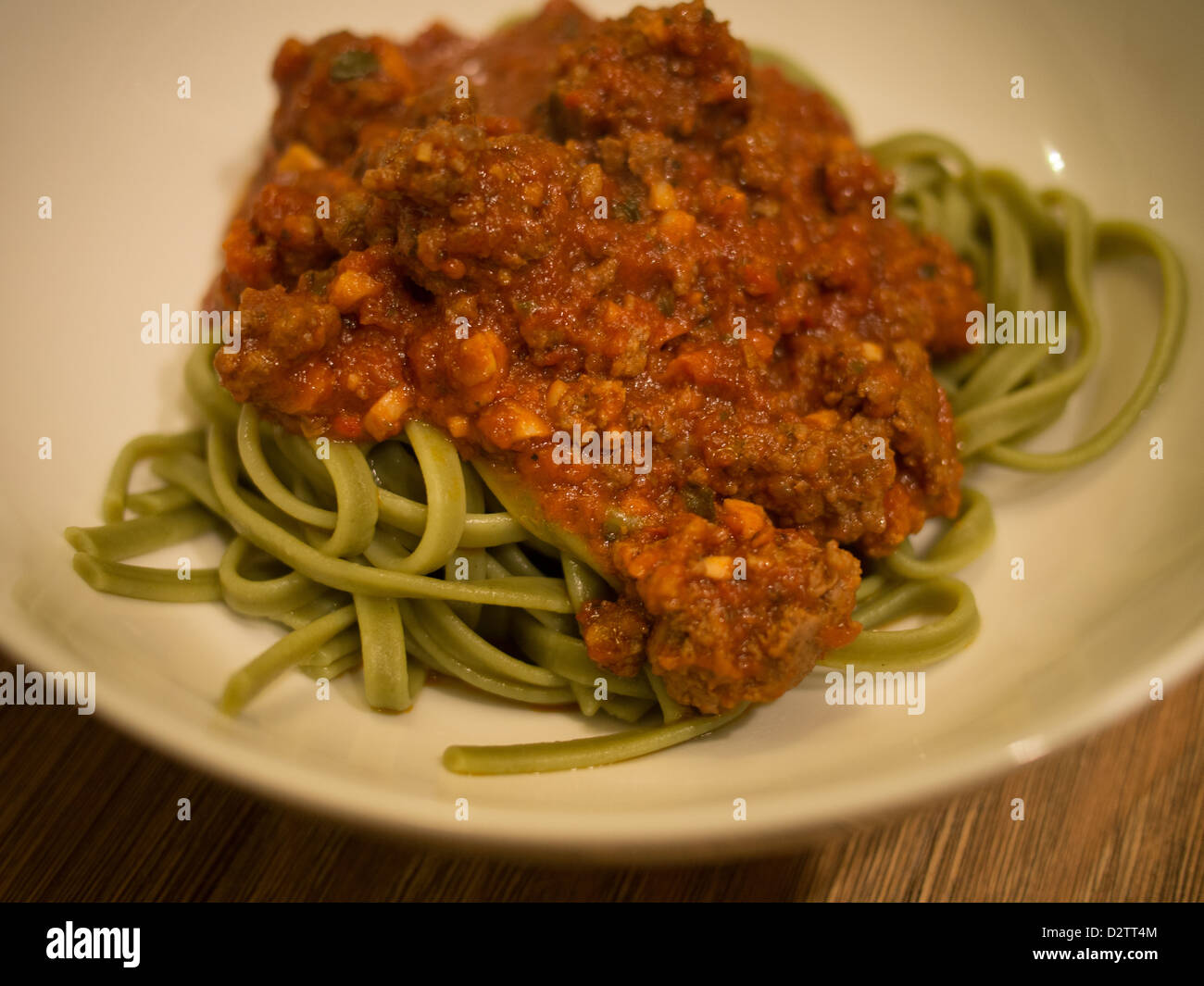 Green spinach spaghetti pasta and meat sauce - Stock Image