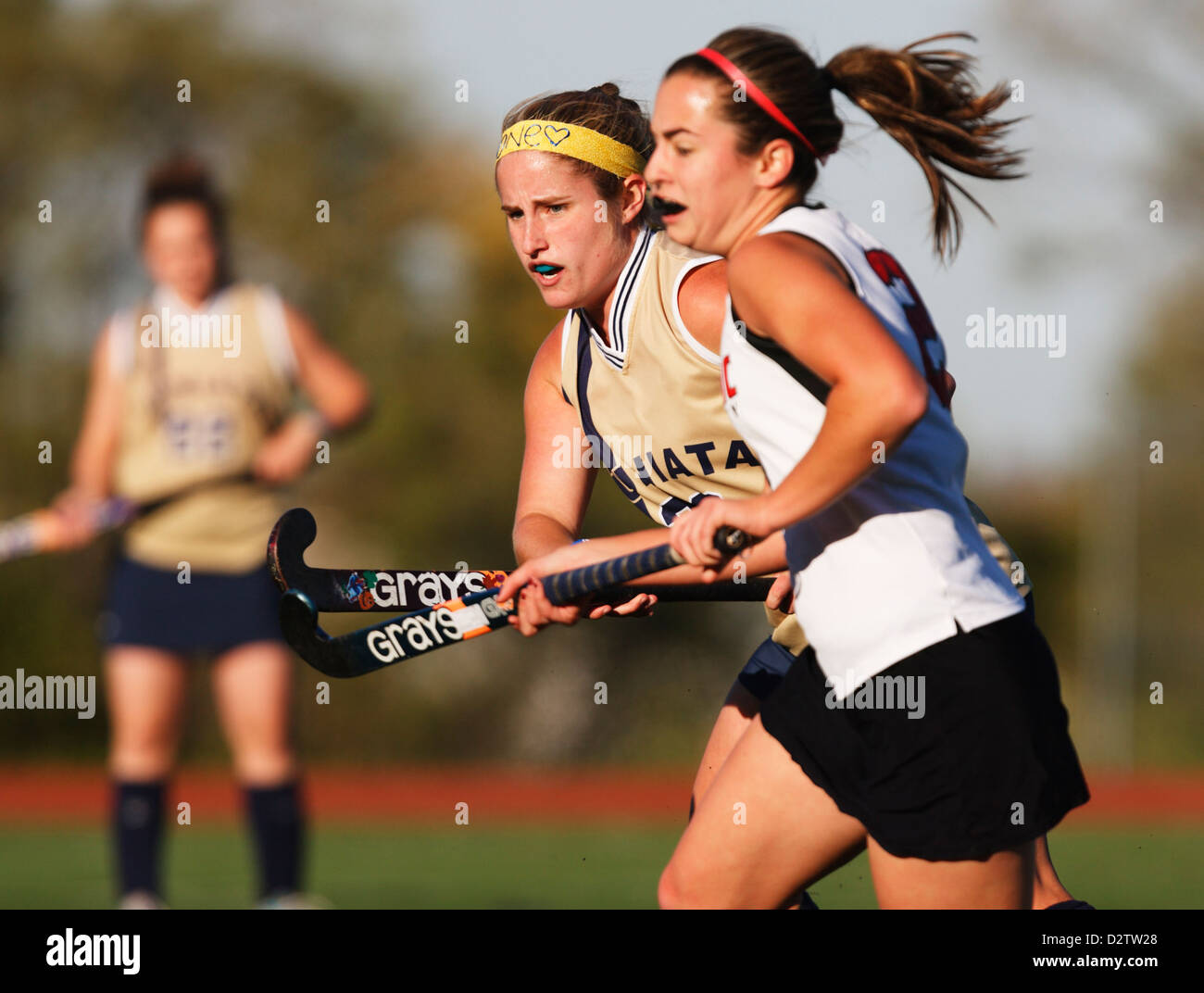 Players from Juniata College (L) and Catholic University (R) compete in the Landmark Conference field hockey championship. - Stock Image