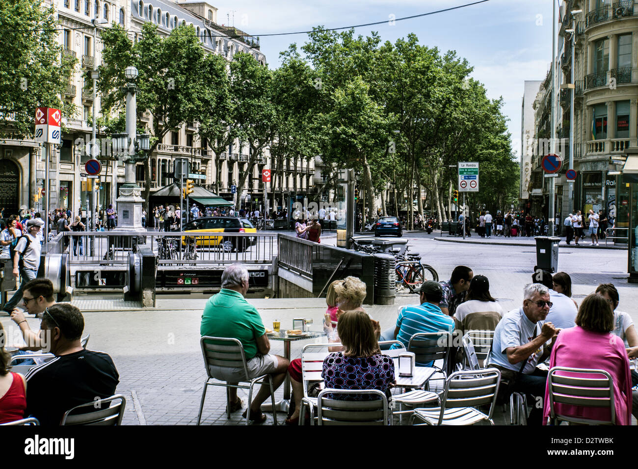 Entrance to La Ramble shopping and entertainment street in Barcelona Spain with tourists and diners enjoying afternoon - Stock Image
