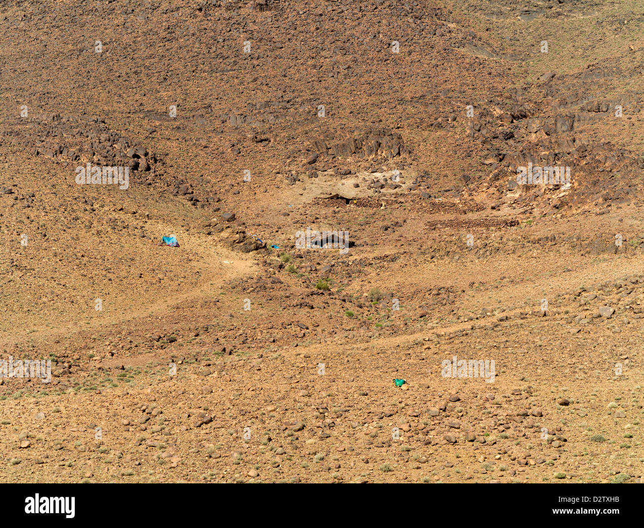 Homes and settlements of Berber nomads in the hills in Boughrar Valley, Morocco, North Africa - Stock Image