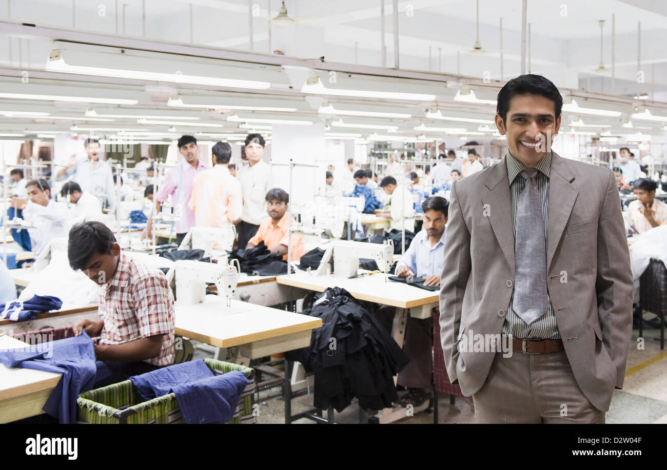 Portrait of a businessman in a textile factory - Stock Image
