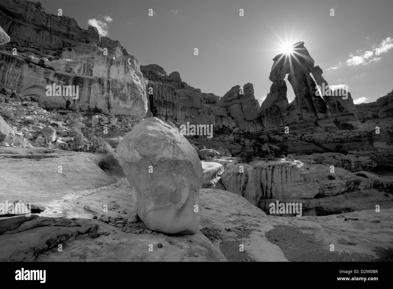 UT00232-00...UTAH - Sun coming over Druid Arch in the Needles District of Canyonlands National Park. - Stock Image