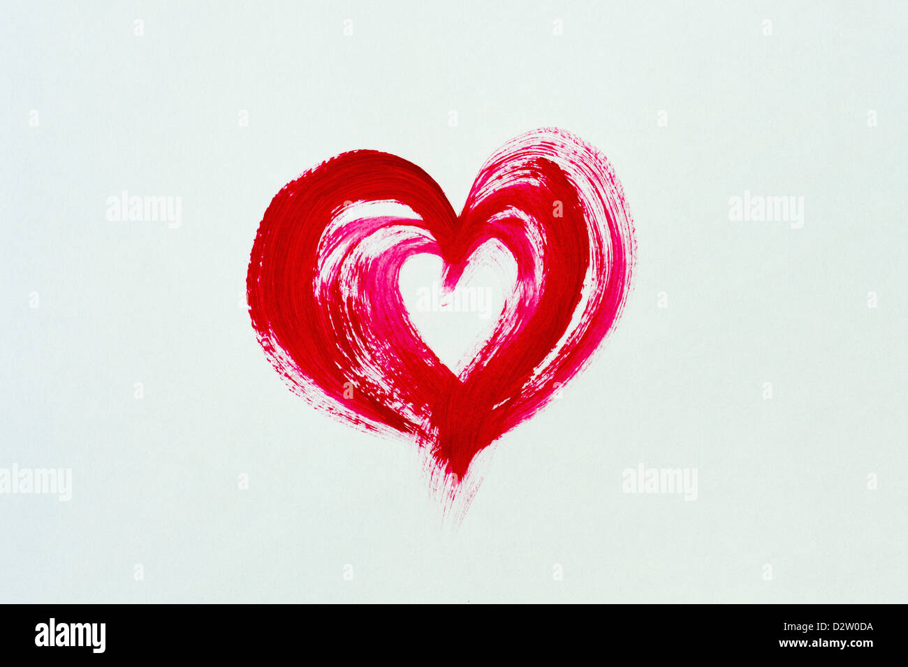 Painted red love heart on white background - Stock Image