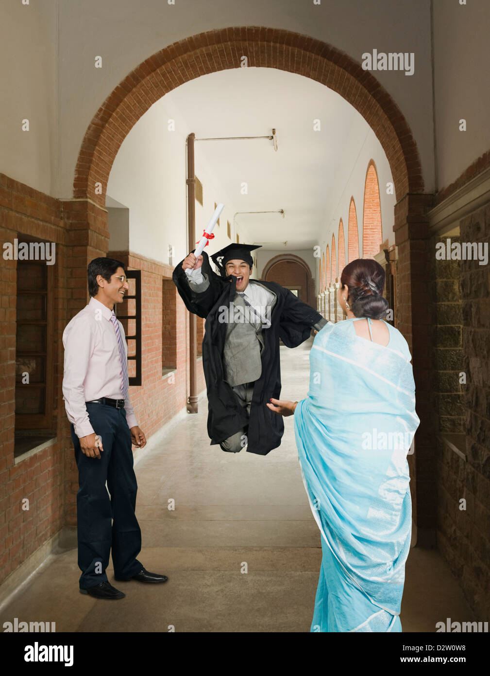 University student celebrating after getting his diploma - Stock Image