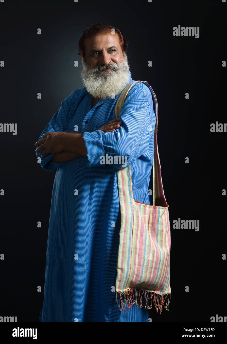 Portrait of a philosopher standing with his arms crossed - Stock Image