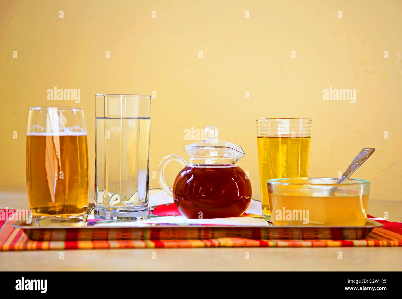 Clear liquid diet items creatively arranged in still life composition.  Diet is used for health and/or gastric/ - Stock Image