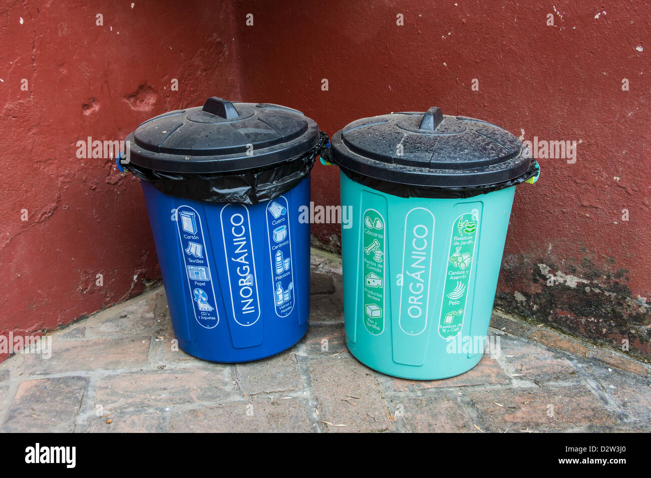 trash cans in Mexico with Spanish text - Stock Image