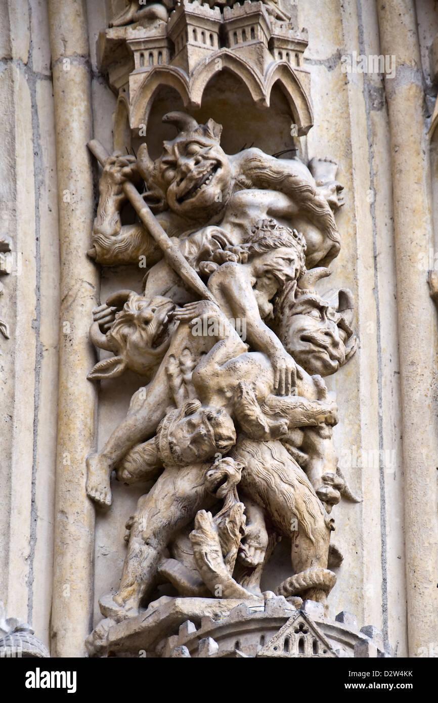 Detail of a sculpture on the facade of Notre Dame de Paris cathedral - Paris, France - Stock Image
