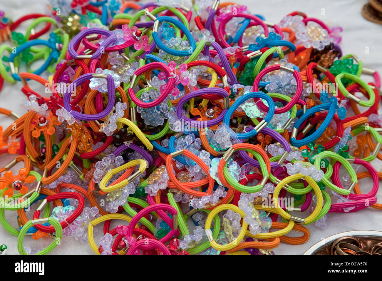 India, Rishikesh. Colorful Hair Ties, Elastic Hair Bands, Pony Tail Holders. - Stock Image