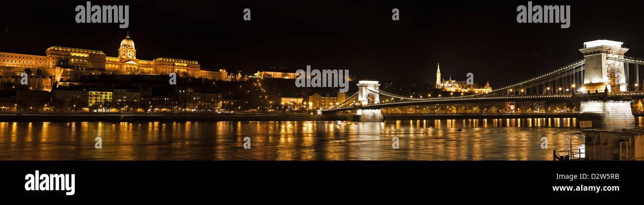 Night Panorama over the Danube featuring the chain bridge and the Buda Palota Stock Photo