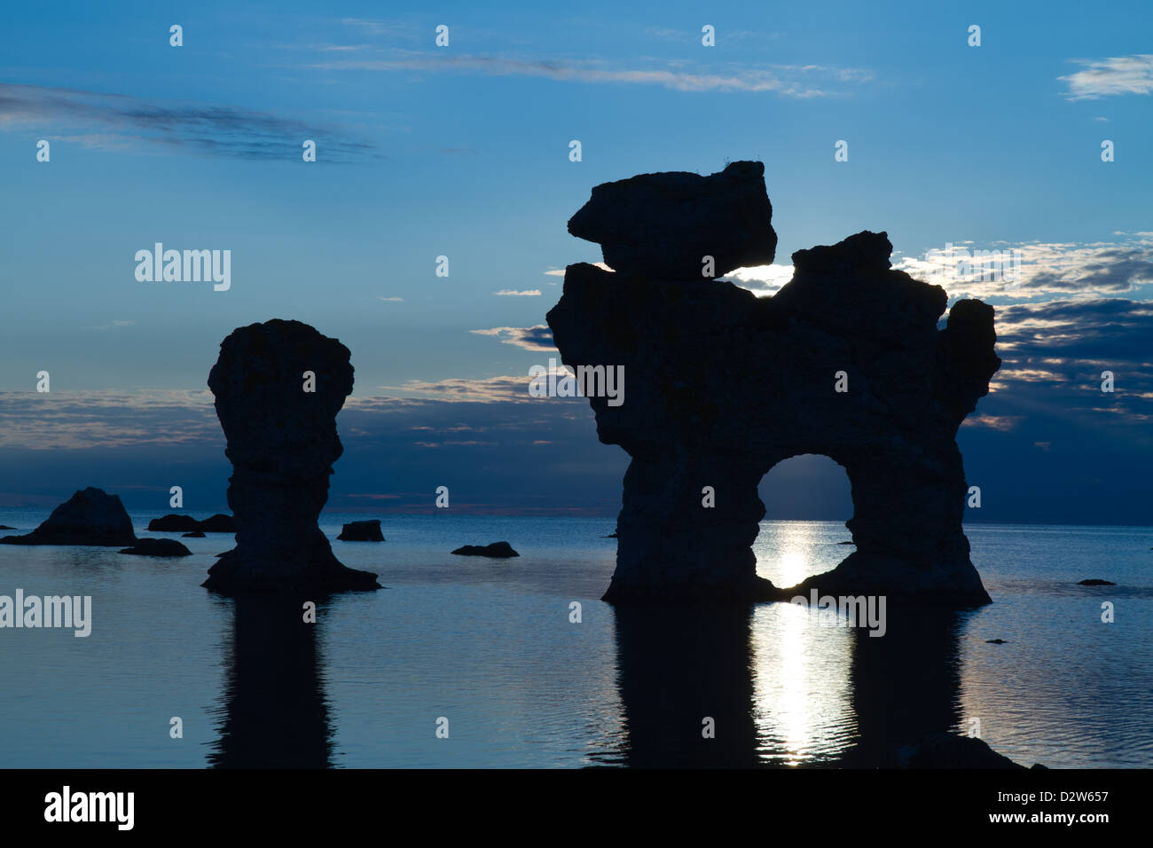 Rauks by sunset. Rauk is the lokal word for seastacks(eroded limestone formations. At Gamle Hamn, Fårö, - Stock Image