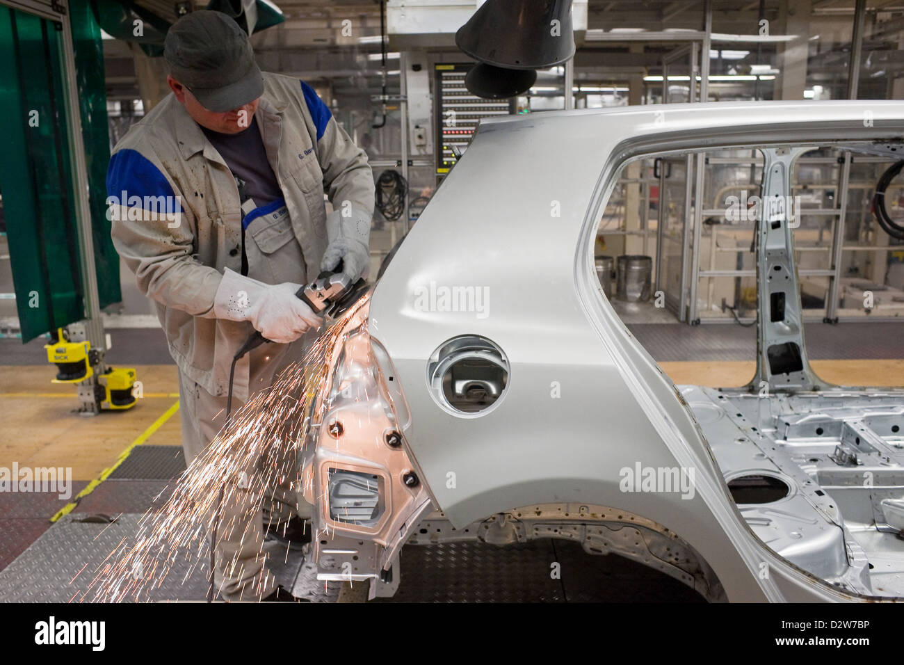 Wolfsburg, Germany, Volkswagen factory, employees in the shell flexes bodyshells - Stock Image