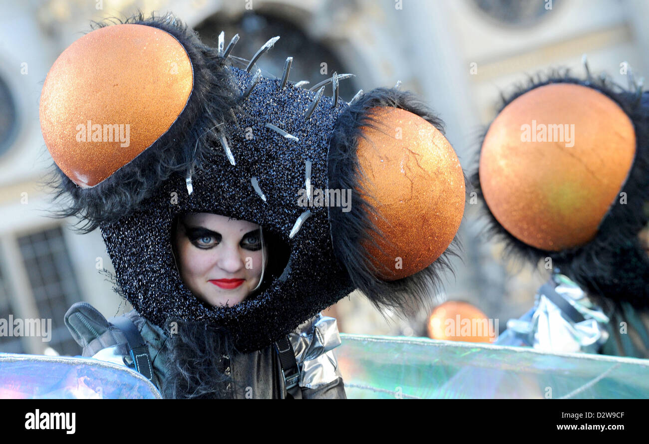 Dressed-up participants in the samba carnival dance in the market square in Bremen, Germany, 02 February 2013. Samba - Stock Image