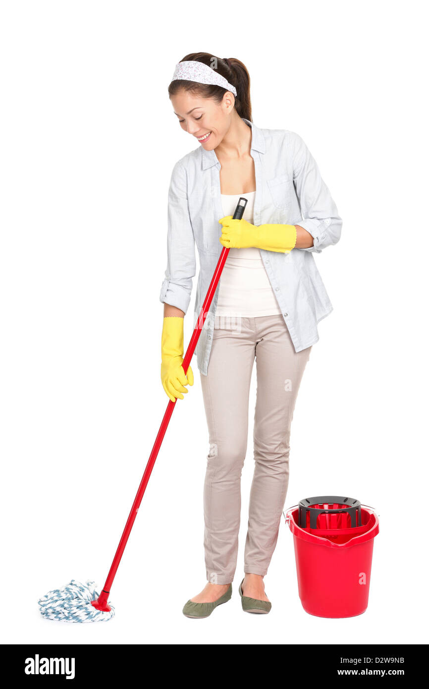 Full length of Chinese Asian / Caucasian woman cleaning floor with mop isolated on white background - Stock Image