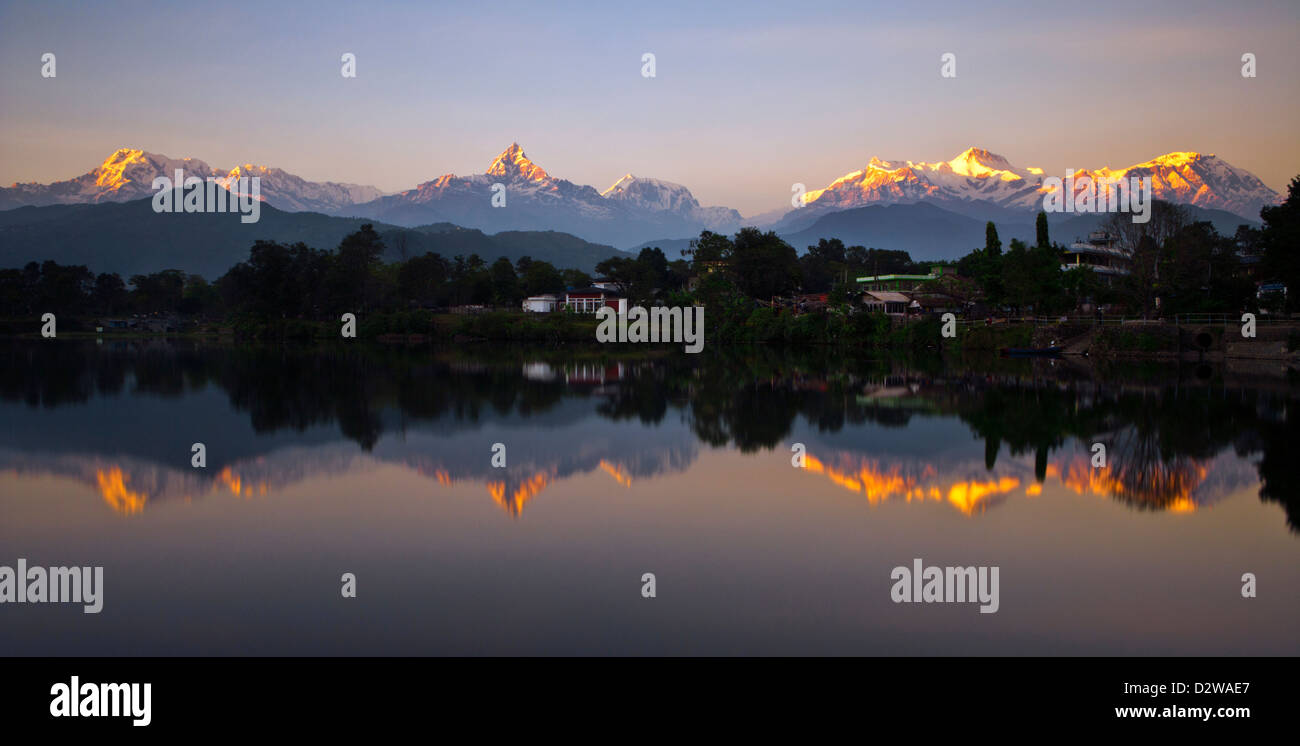 Annapurna mountain range reflecting in lake Phewa in Pokhara, Nepal. - Stock Image