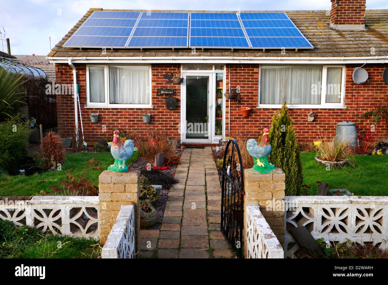 Bungalow with solar panels on roof, Leysdown, Isle of Sheppey, Kent, UK - Stock Image