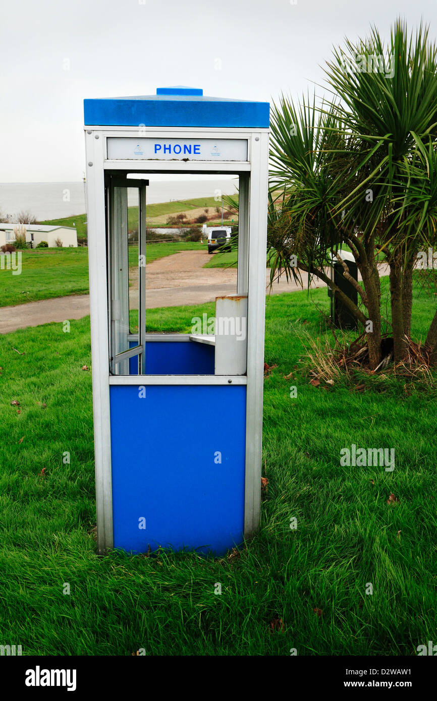 Derelict phone booth, Allhallows Leisure Park, Isle of Grain, Kent, UK - Stock Image