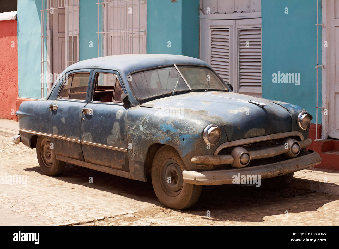 seen better days - classic car parked in street at Trinidad, Cuba, West Indies, Caribbean, Central America in March - Stock Image