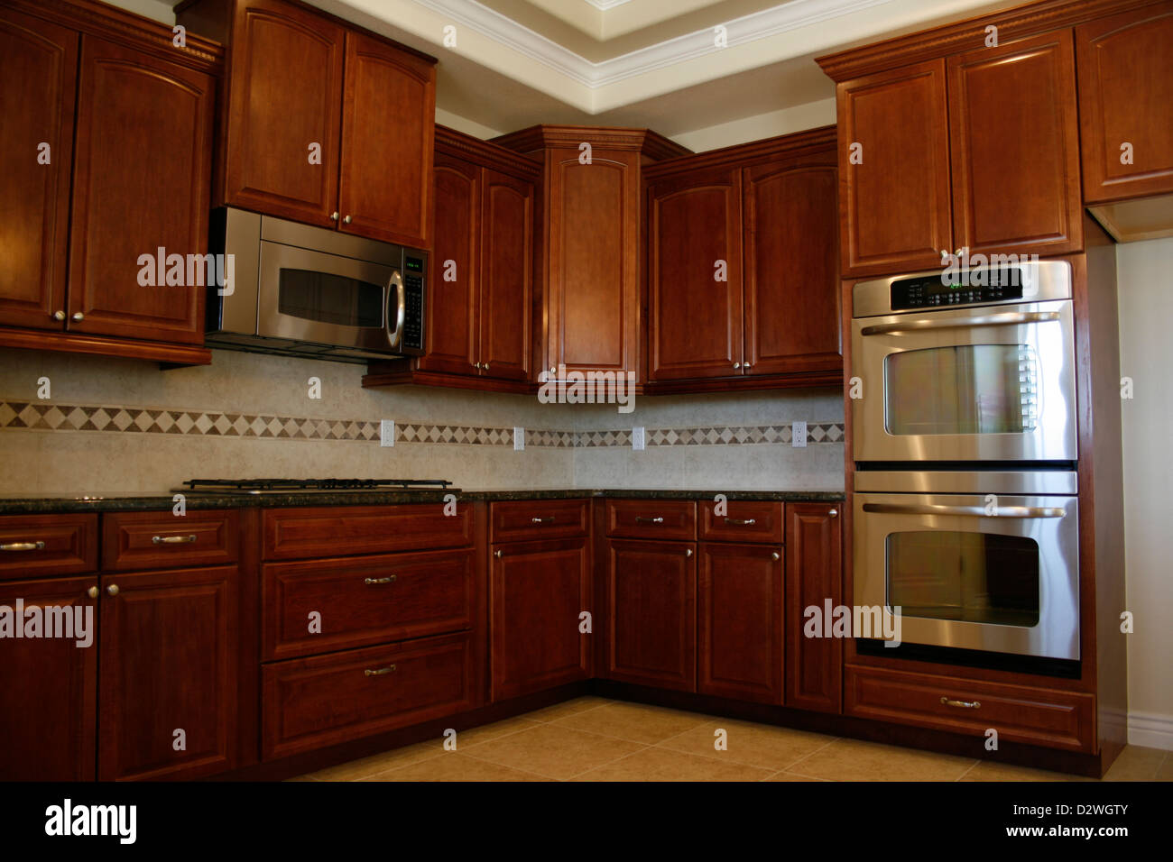 Kitchen cabinets with stainless steel appliances Stock Photo ...