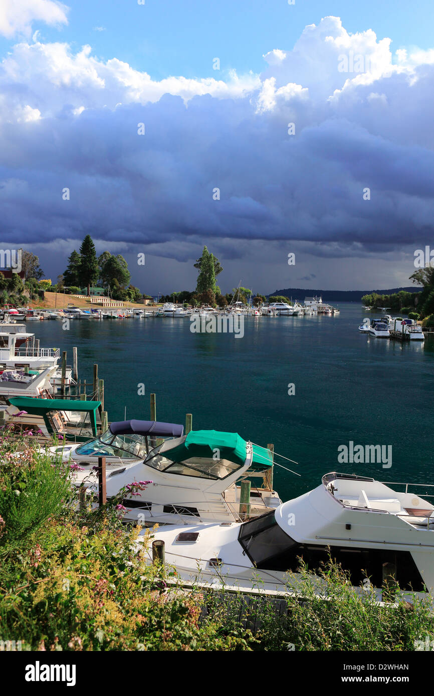 Leisure boats in marina at the head of the Waikato River on Lake Taupo - Stock Image