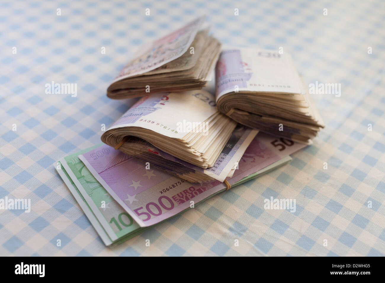 Cash-euros and UK pound sterling banknotes - Stock Image