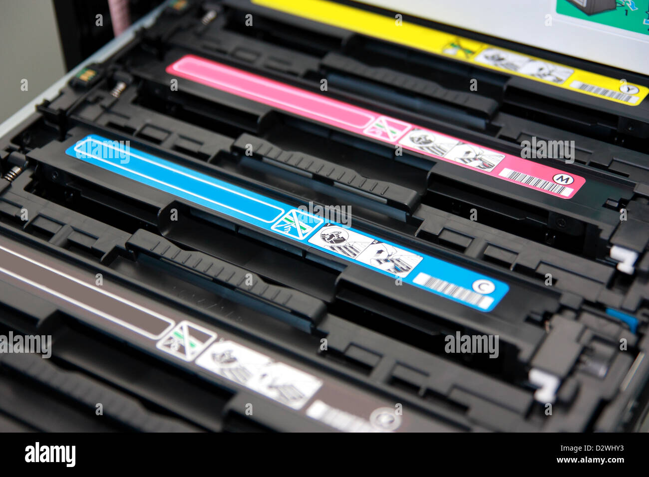 Cartridges of color laser multifunction printer Shallow depth of field. - Stock Image