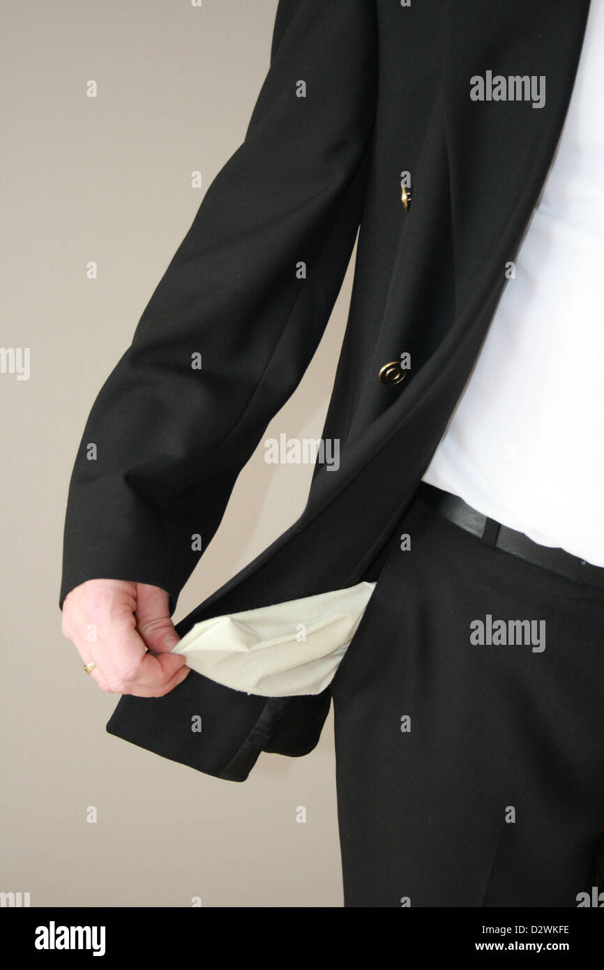 empty pockets without money concept of being broke - Stock Image