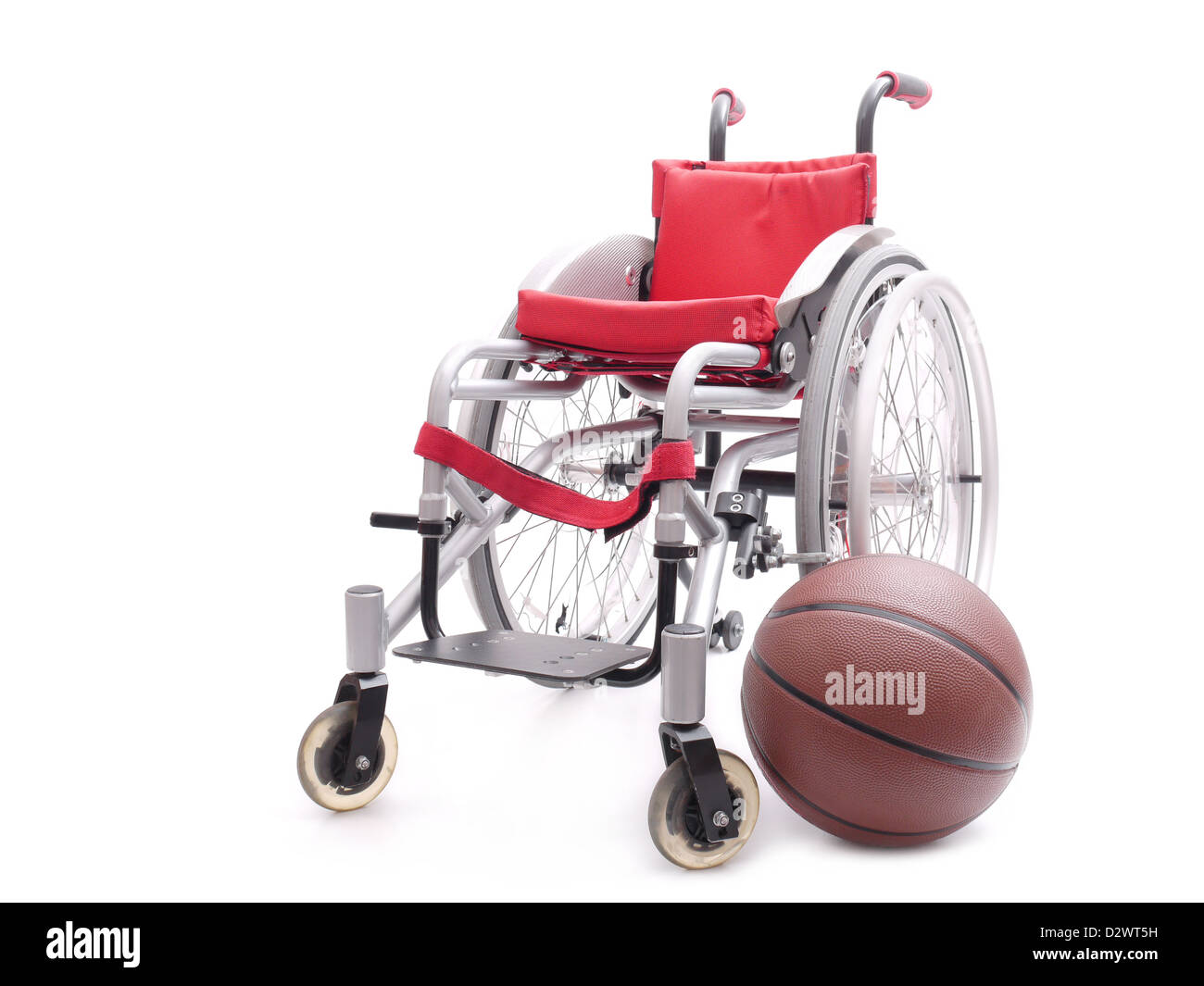 Active wheelchair with basketball shot over white background - Stock Image