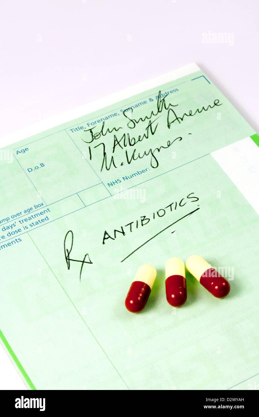 An NHS prescription for antibiotics, with antibiotic drug medicine, England UK - Stock Image