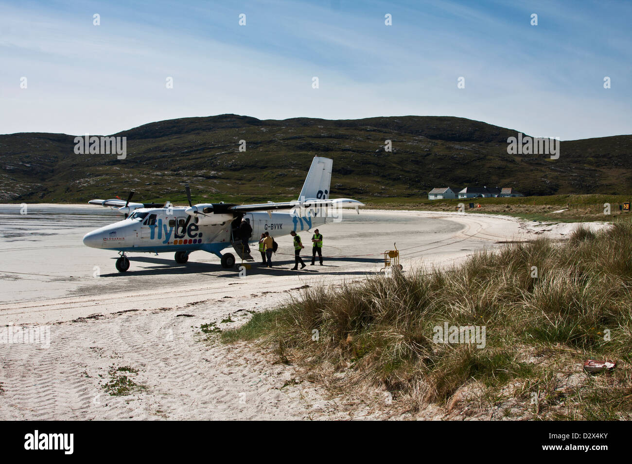 Isle of Barra, Outer Hebrides, Western Isles, Scotland an aircraft loading passengers at the unique beach airport - Stock Image