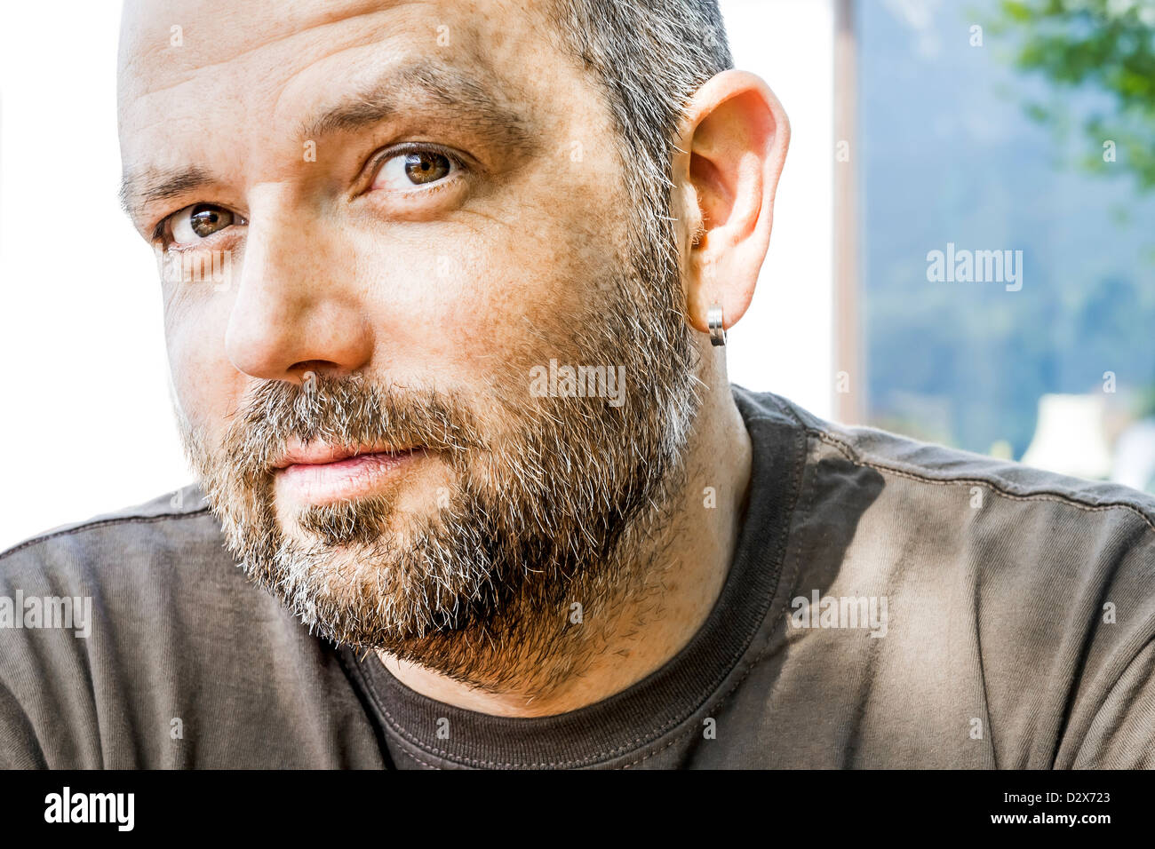 An image of a handsome man with a beard - Stock Image