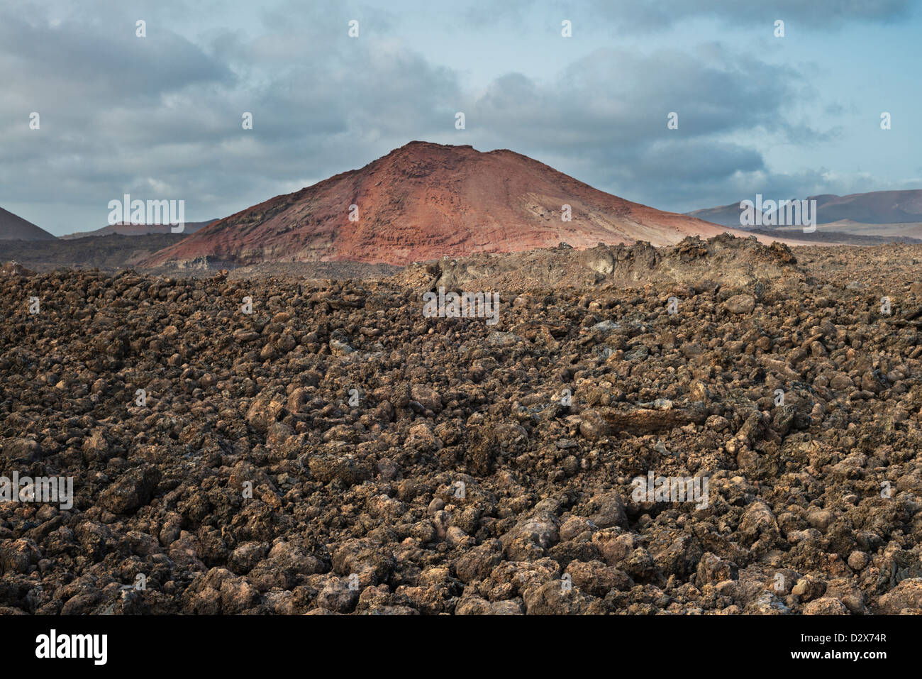 Aa lava field from the historic eruptions on Lanzarote and Montana Bermeja, a volcanic cone in the south-west of - Stock Image