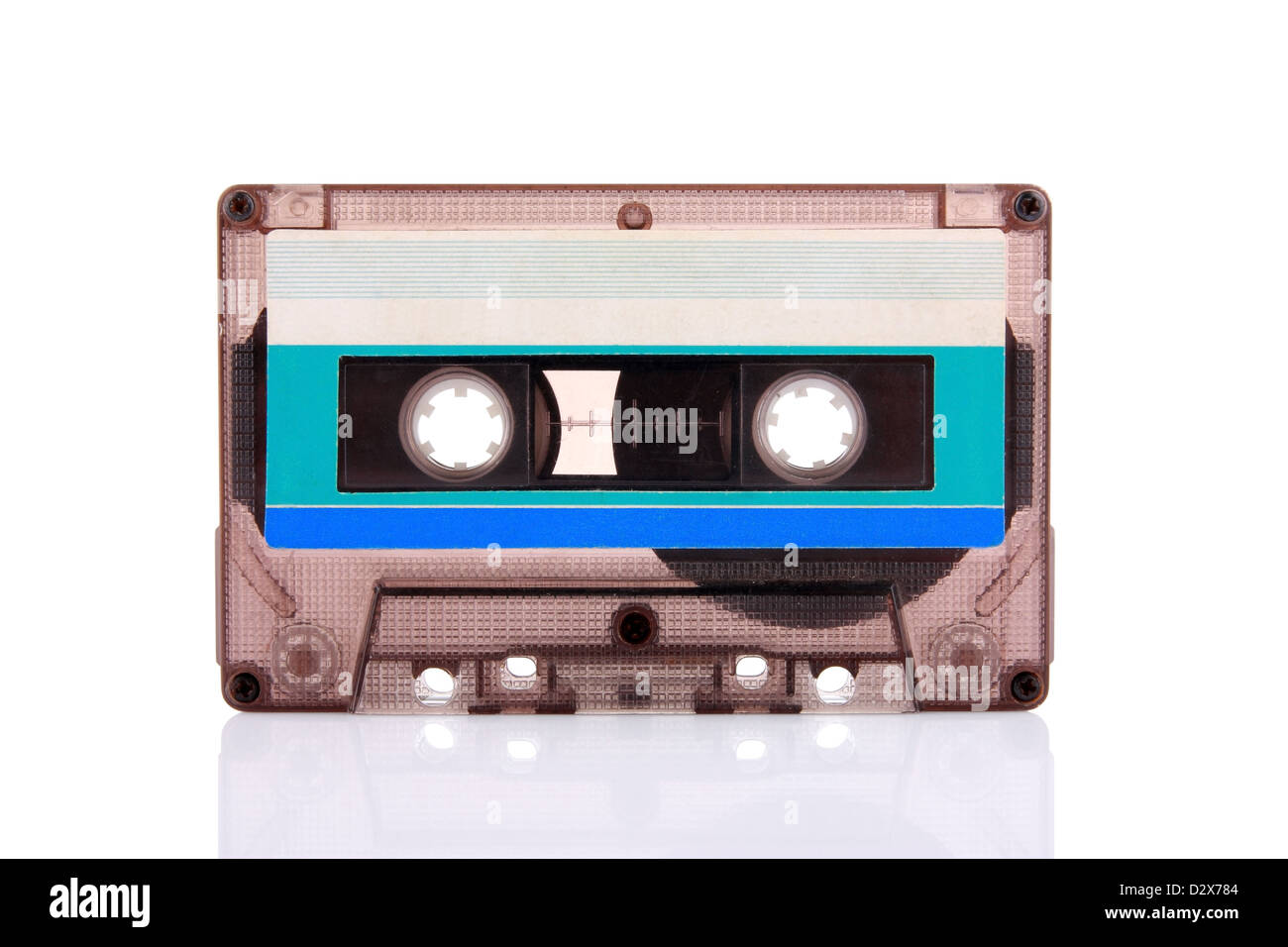 Compact Cassette isolated on white with blank blue label. Including clipping path. - Stock Image